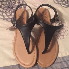 Celia Sandals Plain black sandals. Received this as a gift. Not familiar with the brand. NWT but the price wasn't on it. Unlisted Shoes Sandals