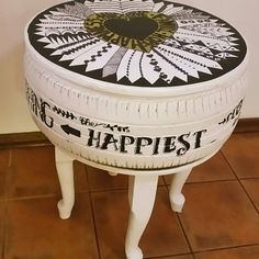 Old car tyre upcycled into a retro coffee table.