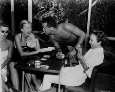 Rest in Peace to legendary actress Joan Fontaine who passed away today at the age of Joan is photographed here playing cards with Dorothy Dandridge & Harry Belafonte on the set of Island in the Sun. Golden Age Of Hollywood, Classic Hollywood, Old Hollywood, Harry Belafonte, Dorothy Dandridge, Black Goddess, British American, Dean Martin, Showgirls