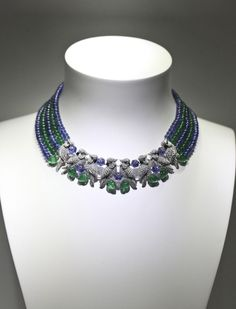 Cartier necklace: Shoulder to shoulder birds carefully crafted in dazzling diamonds, emeralds and sapphire's .