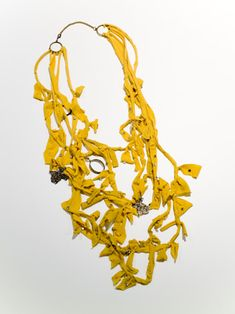 Would you believe this awesome necklace is made from an old pair of tights? Get creative! #TightsTips