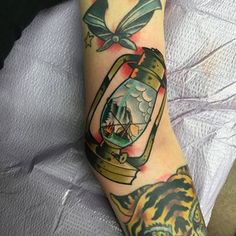 Tattoo done by @vinnypxpx last weekend #lantern #lanterntattoo #camping #colortattoo #denver #colorado #pinetrees #ditch #tribetattoo #tattoosbyvinny  - tribetattoodenver via Instagram