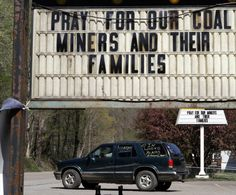 Signs referring to a mining accident at Upper Big Branch Mine are seen in Whitesville, West Virginia, April 10, 2010, after the end of a rescue mission for four coal miners lost in the mine. Four missing West Virginia coal miners were found dead early on Saturday, nearly five days after an explosion killed 25 others in the worst U.S. mining disaster in nearly four decades. Photo by John Gress/Reuters