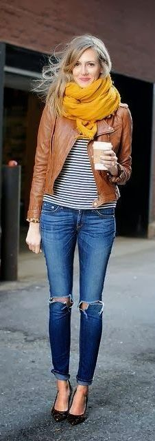 A brown leather jacket over a striped shirt is a classic look you can't go wrong with! Be sure to check out all of these style tips for wearing a leather jacket this fall! Which styling is your favorite?