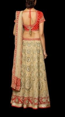 A red/ gold ari tikki embroidered lehnga in organza with a choli and a net dupatta