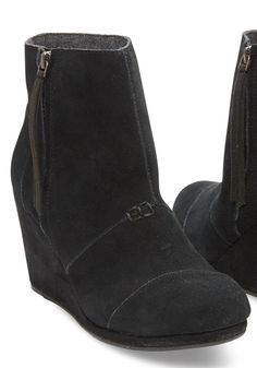 Enjoy the height of a wedge with the closed-toe comfort of a suede bootie. Fashioned with a side zipper for easy on-and-off, wedges are the simplest way to add a dash of chic to your everyday look.