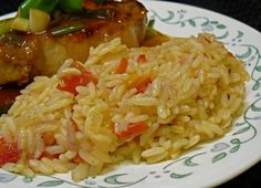 Portuguese Rice: 1 yellow onion, finely chopped 3 garlic cloves, minced 3 cups long grain white rice, washed and drained 4 cups boiling water 1 bay leaf 2 medium tomatoes, chopped Side Dish Recipes, Rice Recipes, Dinner Recipes, Cooking Recipes, Recipies, Peeps Recipes, Dinner Ideas, Pasta Recipes, Healthy Recipes