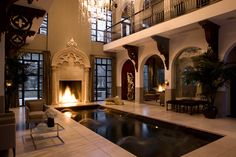 Inspiration for our house plan (minus the pool, chandelier, etc. lol)...One LARGE great room with other rooms surrounding.