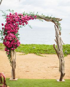 A Tropical, Colorful Wedding in Maui | Martha Stewart Weddings - Christen and Tim's ceremony took place on the beach, complete with an arch of driftwood and roses made by Wild Heart Floral & Event Styling.