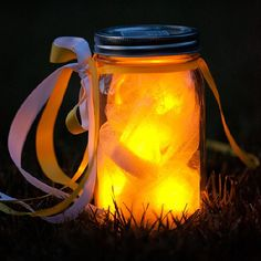 "Create magical party lights with battery operated tea lights individually wrapped in white tulle for a flicking glow of ""fireflies."""