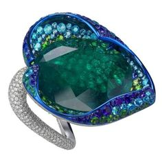 Chopard One-of-a-kind Flower Ring, Cannes Film Festival Red Carpet Collection. 6Blue Sapphires, 10Emerals, 32Demantoids, 42Amethysts, 60Tsavorites, 80Toumaline Parabias and 671Diamonds