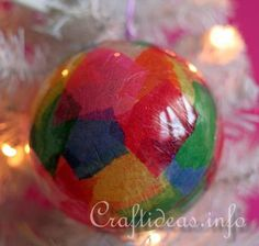 - round acrylic Christmas bauble in size of choice (this ball must be in 2 halves and can be snapped    closed again)  - translucent paper in many colors (they are so pretty when so colorful)  - wallpaper glue or other glue that dries clear  - paint brush