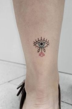 What does evil eye tattoo mean? We have evil eye tattoo ideas, designs, symbolism and we explain the meaning behind the tattoo. Mini Tattoos, Body Art Tattoos, Small Tattoos, Cool Tattoos, Tatoos, Evil Eye Tattoos, Sleeve Tattoos, Tattoo On Eye, Cool Little Tattoos