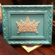 I love this idea! You could glue any symbol or letters into the frame with pearls, sequins, buttons, anything!