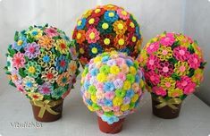 flowerballs. looks like they did a string ball first (starched string over a baloon) then did the flowers onto it