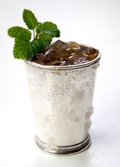 MINT JULEP Kentucky Derby cocktail.For each serving: Crush 4 cups of ice. In a pint glass or cocktail shaker, muddle 8 mint leaves and a teaspoon of brown sugar. Add 2 ounces of bourbon and stir. Pack a julep cup with ice until overflowing. Strain bourbon mixture into cup. Stir drink until the outside of the cup frosts. Top with more ice, garnish with a fresh mint spring, and serve.