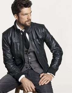 Black Leather Jacket, Grey Vest, Fitted Jeans, and Black Tie. Men's Fall Winter Fashion.