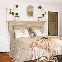Love the fireplace mantel headboard and skirted bedspread