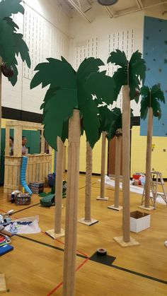 Palm Trees made of carpet tubes and cardboard leaves.