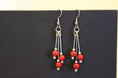 Interested? Use discount code 3FOR20 at checkout! https://www.etsy.com/listing/272993210/red-silver-drop-earrings