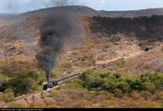 One of the few remaining operating steam locomotives on the NRZ has just emerged from the only tunnel on the entire Zimbabwean Railway System. Geoffs Trains runs a photographic safari to Zimbabwe each year during May and the Big Game captured on camera are Steam Locomotives.