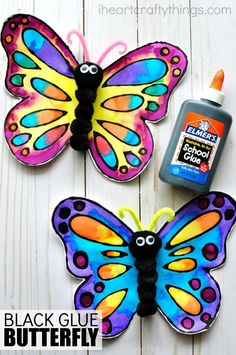 This watercolor and black glue butterfly craft makes a beautiful spring kids craft, art project for kids, butterfly craft for kids and insect craft. Sponsored by Elmer's. #ArtsandCrafts