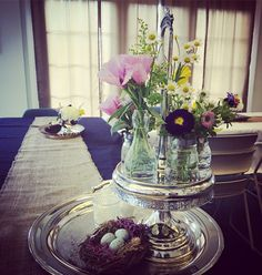Spring flowers in a repurposed vintage silver caster.