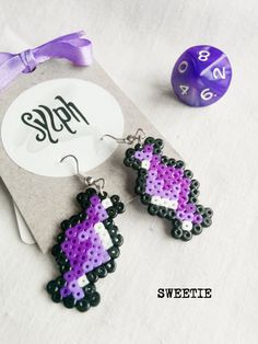 Shades of purple pixelated Sweetie earrings with an 8bit retro vibe made of Hama Mini Perler Beads, perfect for candy fans! by SylphDesigns on Etsy