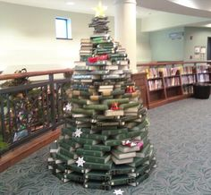 The Christmas Tree of Knowledge :: Brian Herzog Christmas Tree Made Of Books, Fall Library Displays, Book Tree, Swiss Army, Book Stuff, Libraries, Happy Holidays, Knowledge, Reading