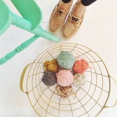 Love this color palette and vintage basket to store yarn.