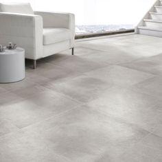 Vloertegel, 60x60 cm lichtgrijs. Met betonlook. Rak Cementino. Strak zonder dat het saai wordt...