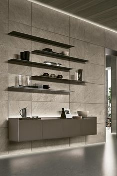 Rimadesio Modulor is a contemporary wall panelling system that enables the seamless integration of internal doors. Modulor looks amazing as simple wall cladding, or in conjunction with any of the Rimadesio collection of suspended cabinets. The panels are available in Porcelain, back painted glass, wood, synthetic leather and Fabric. #DreamDesign #LuxuryInterior #luxurydesign #wallpanel #architecture #architecturelovers #luxuryhomes #beautifulhomes #walldecor #walldesign #luxuryinteriordesign Wall Panelling, Wall Cladding, Glass Design, Wall Design, Bookshelves, Bookcase, Back Painted Glass, Tv Bench, Loft