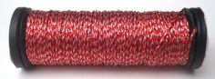 Kreinik color 332, a red and white blend, perfect for Christmas :)