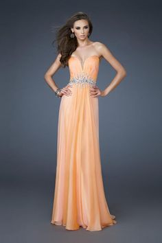 """Start out searching for your perfect long maxi strapless light orange prom dress by flipping through magazines and online to see what kind of dress you are most attracted to. Then hit the stores with an idea in mind of what you are looking for. Try on as many dresses as you can; your idea of the """"perfect dress"""" may not be as well suited for you as another style. Don't limit yourself."""