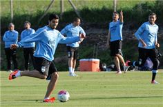 Uruguay's national football team player Luis Suarez, kicks a ball during a training session at the Uruguayan Football Association's sports complex in the department of Canelones, near Montevideo, on May 27, 2013. Uruguay will face France in a friendly match on June 5 and Venezuela in the South American qualifiers for the Brazil 2014 World Cup on June 11