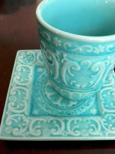 Turquoise coffee mug and saucer