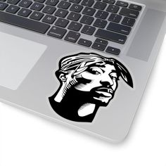 This kiss cut sticker features a well-known 90s rapper. Inspired by Tupac Shakur, this is sticker is made especially for hip-hop fans. It can be easily implemented into indoor or outdoor use. There are 4 transparent styles to choose from, including: 2x2, 3x3, 4x4 and 6x6. Based on the image, this Tupac Shakur, 2pac, Tupac Art, African American Literature, Black Authors, Gifts For Readers, Black Women Art, Rap Music, Friends In Love