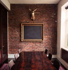 Meeting room idea. Framed Chalkboard and a fancy chalk holder would be nice here.