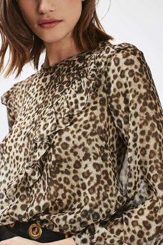 Add an edge to animal print in this cool leopard print sheer blouse with a ruffle detail to the front and shoulders. Wear tucked in with light wash jeans and heeled sandals for a day-to-night look. #Topshop