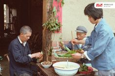 Dragon Boat Festival tradition: A peasant family in Hubei, poet Qu Yuan's home province, making zongzi (sticky rice mingled with read beans or red jujubes or salty pork meat or salty egg yolk wrapped in reed leaves) in 1982
