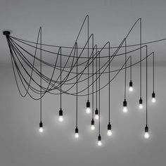 Maman is a set of 14 LED suspension lights, linked to a central base by black silicon cables. Maman is available 2 versions: Dimmable Satin or Dimmable Traspare
