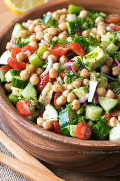 Chickpea Salad combines fresh vegetables including tomatoes, cucumbers and avocados in an easy homemade lemon kissed dressing.