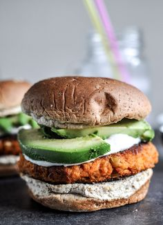 Smoky Sweet Potato Burgers with Roasted Garlic Cream and Avocado | howsweeteats.com