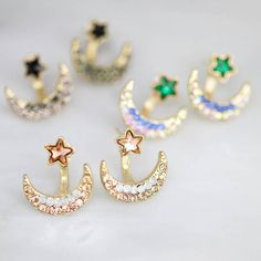 These beautiful two-way moon and star earrings make a great gift for any fashion concious female and perfect for the festive season! The gold coloured earrings are adorned with coloured rhinestones. Add these to any simple outfit for a little glitz and glamour. The earrings will arrive wrapped in an ivory organza gift bag ready for you to treat your loved one.  Made from: Gold tone zinc, alloy and Rhinestone  Dimensions: Star measures approx 0.6cm, moon measures approx 1.7 x 0.4 cm.