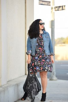 Girl With Curves blogger Tanesha Awasthi wears a floral print dress, floral print scarf, denim jacket and booties from Old Navy.