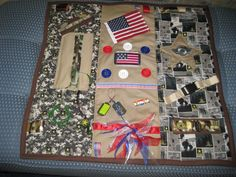 My 1st attempt at a military themed fidget blanket for my residents with Alzheimer's