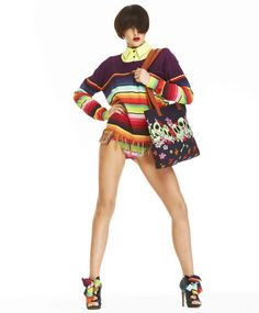 I wouldn't think to pair an oxford collar below this serape-style sweater. What else could I do to upscale the sweater? Anything remotely Boho just ages me too much.