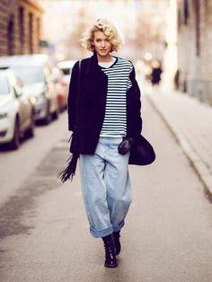 Zanita in an oversized striped shirt and baggy boyfriend jeans