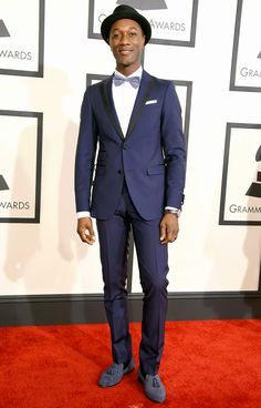 It wasn't just about the ladies' styles—the boys cleaned up nice, too! Music's men turned it out at the 2015 Grammys on Sunday, Feb. 8, in Los Angeles, clad in a series of colorful suits and tuxedos. See our favorite men in tuxes including Sam Smith, Pharrell Williams, Nick Jonas, and more!