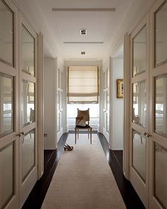 beautiful hallway, if only the glass was replaced with true wood paneling, then it would be even more gorgeous
